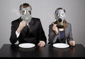 Couple at gas masks on a gray background Stock Image