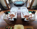 Couple getting a massage at spa resort Royalty Free Stock Photos