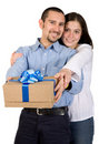 Couple with a gift Stock Images