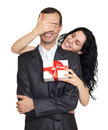 Couple with gift box, studio portrait on white. Woman close man eyes. Dressed in black suit. Royalty Free Stock Photo