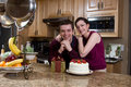 Couple With Gifts in the Kitchen - Horizontal Royalty Free Stock Photo