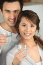 Couple with glasses of water Royalty Free Stock Photo