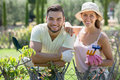 Couple in gloves with horticultural sundry happy garden Stock Photography