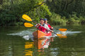 The couple goes kayaking on the river. Royalty Free Stock Photo