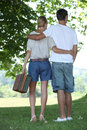 Couple going on a picnic in park Royalty Free Stock Images