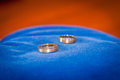Couple of gold wedding rings on blue velvet background Royalty Free Stock Image
