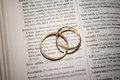 Couple of gold wedding rings in book Royalty Free Stock Photo