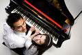 Couple with Grand piano 5 Stock Images
