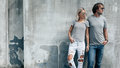 Couple in gray t-shirt over street wall Royalty Free Stock Photo