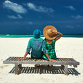 Couple in green on a beach at maldives tropical Stock Images