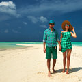 Couple in green on a beach at maldives tropical Royalty Free Stock Photo