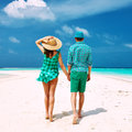 Couple in green on a beach at maldives tropical Royalty Free Stock Photography