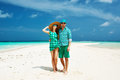 Couple in green on a beach at maldives tropical Royalty Free Stock Images
