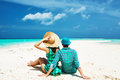 Couple in green on a beach at maldives tropical Stock Photos