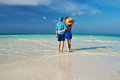 Couple in green on a beach at maldives tropical Stock Photo