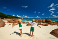 Couple in green on a beach at seychelles tropical Royalty Free Stock Photos