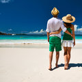 Couple in green on a beach at seychelles tropical Royalty Free Stock Photo