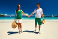 Couple in green on a beach at seychelles tropical Stock Image