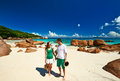 Couple in green on a beach at seychelles tropical Royalty Free Stock Image