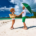 Couple in green on a beach at seychelles tropical Stock Images