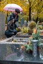 Couple In Grief On A Cemetery ...