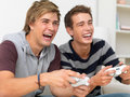 A couple of guys using a gaming console Royalty Free Stock Images