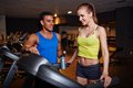 Couple in gym fit girl and guy activewear spending time Stock Photo