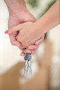 Couple hands with key of new home Royalty Free Stock Image