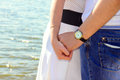 Couple hands young holding with love and tenderness outdoors near water sea river Royalty Free Stock Image