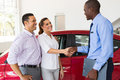 Couple handshake car salesman beautiful with after purchasing a Royalty Free Stock Photography