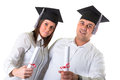 Couple of happy graduating students over white background Stock Photo