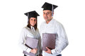 Couple of happy graduating students over white background Royalty Free Stock Photos