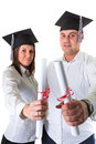 Couple of happy graduating students over white background Stock Photos