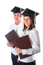 Couple of happy graduating students over white background Royalty Free Stock Image