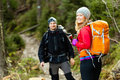 Couple happy hikers walking in mountains man and women trekking young with backpacks forest tatra poland trekking hiking Royalty Free Stock Photography