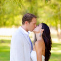 Couple happy in love kissing in the park Royalty Free Stock Photo