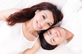 Couple happy smile looking to each other in bed young lovely lying a you top view asian people Stock Photos