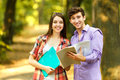 Couple of happy students with books in the Park Royalty Free Stock Photo