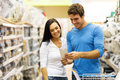 Couple hardware store cheerful young shopping in Stock Photos