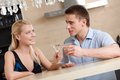 Couple has dating dinner supper in the kitchen Royalty Free Stock Photography