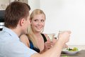 Couple has dating supper dinner in the kitchen Stock Images