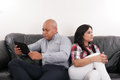 A couple having argument while sitting on the sofa Stock Images