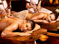 Couple having ayurvedic spa treatment oil ayurveda Royalty Free Stock Image
