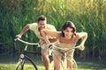 Couple having a bicycles race into the nature in garda lake Stock Photos