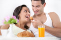 Couple having breakfast in bed beautiful smiling young morning Stock Images