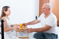 Couple having breakfast in bed woman and men sitting on white near tray with Royalty Free Stock Images