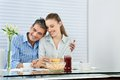 Couple having breakfast happy together at the table Royalty Free Stock Images
