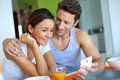 Couple having breakfast at home Royalty Free Stock Photo