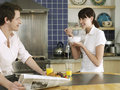 Couple having breakfast at kitchen table happy young Royalty Free Stock Images