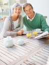 Couple having a casual talk at the breakfast table Royalty Free Stock Images